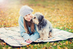 Cute girl with a dog in park. Autumn colors Stock Photography