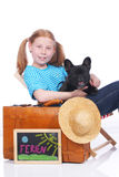 Cute girl with dog and suitcase Royalty Free Stock Photography
