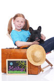 Cute girl with dog and suitcase Stock Photos