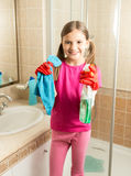 Cute girl doing cleaning at bathroom holding rag and spray Royalty Free Stock Photos