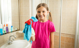 Cute girl doing cleaning posing with blue rag Stock Photo