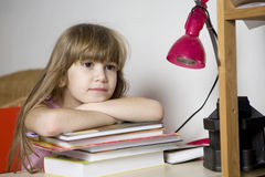 Cute girl doing homework Stock Photos