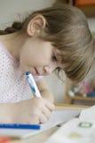 Cute girl doing homework Stock Photos