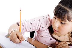 Cute girl doing homework Royalty Free Stock Images