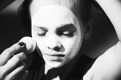 Little girl doing makeup mime on the street. Cute girl doing makeup mime on the street Stock Image