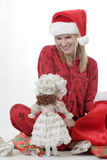 Cute girl with doll for Christmas Stock Image