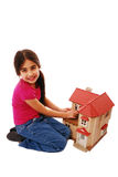 Cute girl with dolls house Stock Images