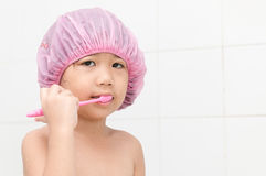 Cute girl don't like to brushing teeth. Stock Photo