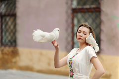 Cute girl with dove in the hand Royalty Free Stock Photo