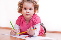 Cute girl is drawing Stock Images