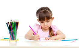 Cute girl drawing with colourful pencils Royalty Free Stock Photography