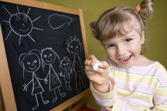 Cute girl drawing family Royalty Free Stock Photo