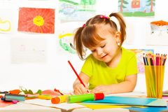 Cute girl drawing Stock Photos