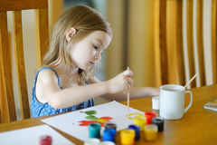 Cute girl is drawing with paints in preschool Stock Photos
