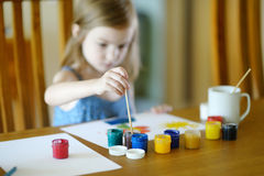 Cute girl is drawing with paints in preschool Royalty Free Stock Photos