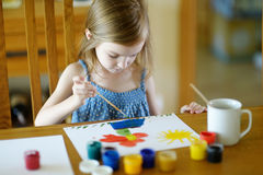 Cute girl is drawing with paints in preschool Royalty Free Stock Photo