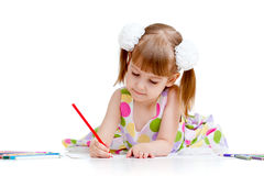 Cute girl drawing a picture with color pencils Royalty Free Stock Image