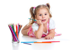 Cute girl drawing a picture with color pencils Royalty Free Stock Photo
