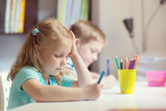 Cute girl drawing at school stock photo