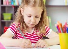 Cute girl drawing at school Royalty Free Stock Photo