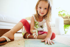 Cute girl drawing sitting on the floor Royalty Free Stock Image