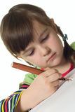 Cute girl draws color marker Royalty Free Stock Photos