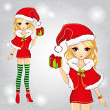 Cute Girl Dressed As Santa Claus Holding A Gift Stock Photography