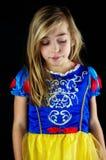 Cute girl dressed as Snow White. Cute girl looking down dressed as Snow White Stock Photo