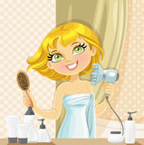 Cute girl dries her hair hairdryer in the bathroom Stock Image