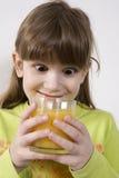 Cute girl drink orange juice Royalty Free Stock Photos