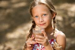 Cute girl drinking milk chocolate. Stock Photos