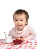 Cute girl drinking tea with berries Royalty Free Stock Images