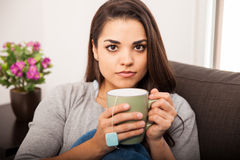 Cute girl drinking tea at home Stock Photo