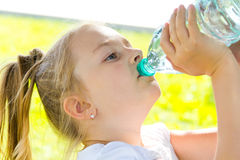 Cute girl drinking water Stock Photography