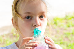 Cute girl drinking water Royalty Free Stock Images