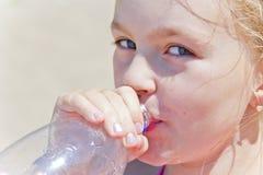 Cute girl drinking water Stock Photo