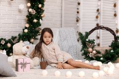 Free Cute Girl Drinks Hot Cocoa And Plays With Teddy Bear At Home. Christmas Stock Images - 133370364