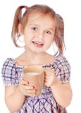Cute girl drinks milk isolated on white Royalty Free Stock Photo