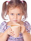 Cute girl drinks milk isolated on white. Foto-Cute girl drinks milk isolated on white Stock Image