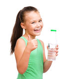 Cute girl drinks water from a plastic bottle Royalty Free Stock Photography