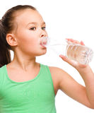 Cute girl drinks water from a plastic bottle Royalty Free Stock Photos