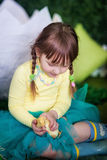Cute girl with duckling Stock Photo