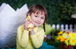 Cute girl with duckling Stock Photos