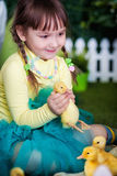 Cute girl with duckling Stock Image