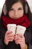 Cute girl in earplugs with coffee cup Royalty Free Stock Image