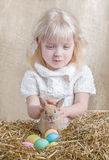 Cute girl with Easter bunny Stock Images