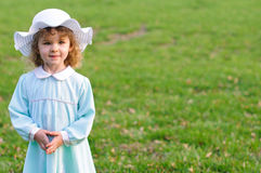 Cute Girl in Easter Dress and Bonnet Royalty Free Stock Images