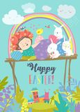 Cute girl with Easter rabbits and Easter eggs Stock Photos