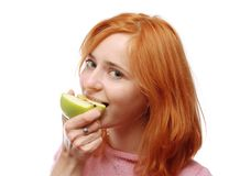 Cute girl eating an apple Stock Photography
