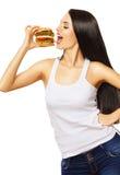 Cute girl eating big hamburger Royalty Free Stock Photography